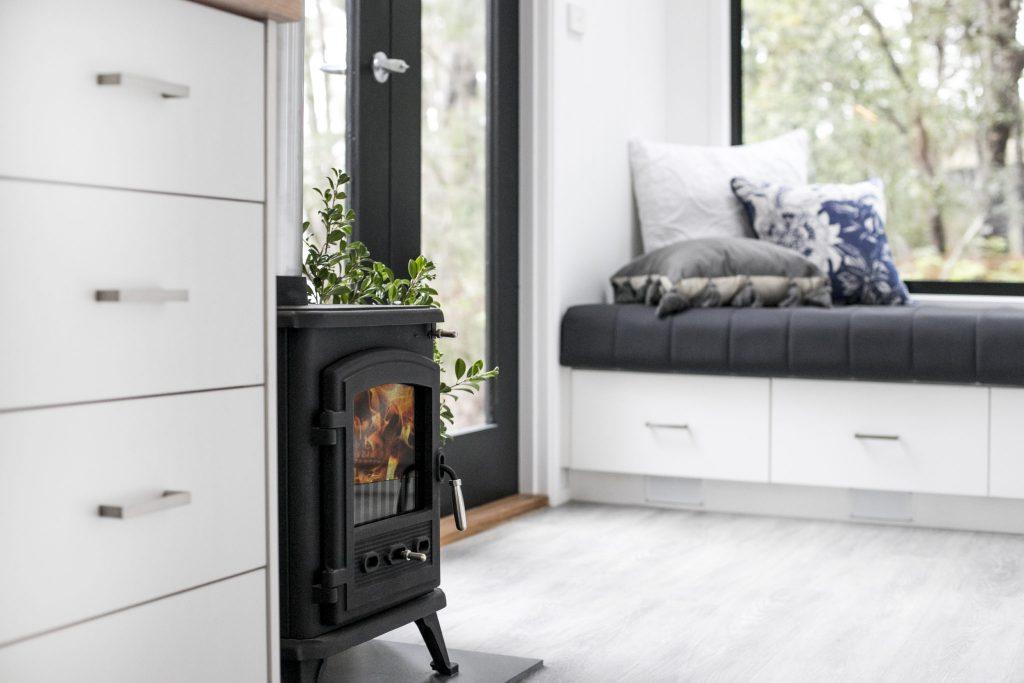 couvaras architects tiny house interior fireplace